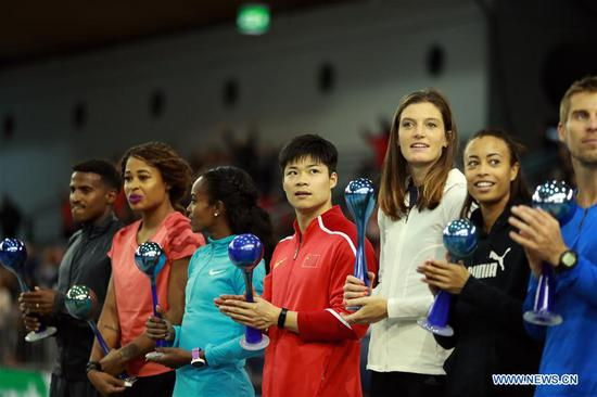 Su Bingtian (4th L) of China attends the awarding ceremony after winning Men's 60m final of the 2018 IAAF World Indoor Tour in Karlsruhe, Germany, on Feb. 3, 2018. Su Bingtian claimed the title with 6.47 seconds.(Xinhua/Luo Huanhuan)