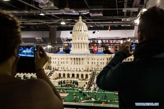 Visitors take photos of LEGO U.S. Capitol at a LEGO exhibition in Warsaw, capital of Poland, on Feb. 4, 2018. A major LEGO exhibition, made up entirely from Lego with 10 million pieces and containing notable creations, is held at Warsaw National Stadium from Jan. 29 to March 25. (Xinhua/Chen Xu)