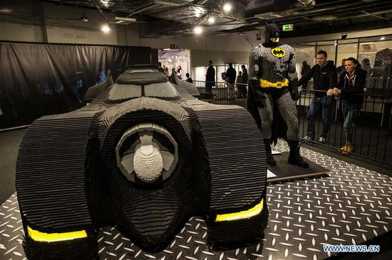 People look at LEGO Batman and his Batmobile at a LEGO exhibition in Warsaw, capital of Poland, on Feb. 4, 2018. A major LEGO exhibition, made up entirely from Lego with 10 million pieces and containing notable creations, is held at Warsaw National Stadium from Jan. 29 to March 25. (Xinhua/Chen Xu)