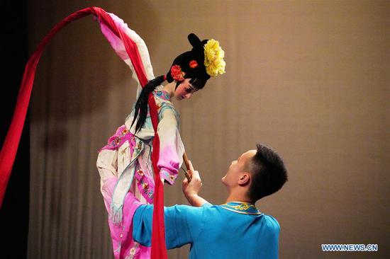 An artist performs puppet dance during a Chinese cultural performance at the Royal Cultural Center in Amman, Jordan, on Feb. 5, 2018. A series of Chinese cultural shows on Monday kicked off in Amman to celebrate the upcoming Chinese New Year which falls next week. (Xinhua/Lin Xiaowei)