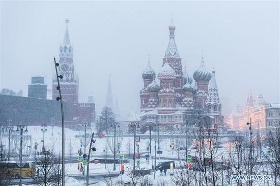 Photo taken on Feb. 5, 2018 shows the Spasskaya Tower (L) and the Saint Basil's Cathedral at the red square in Moscow, Russia, on Feb. 5, 2018. Moscow experienced a record strong snowfall last week, which caused delays and cancellations of air flights and the death of at least one victim, officials said.
