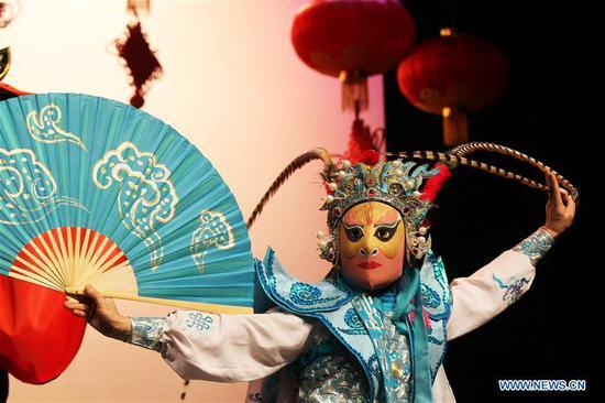 An artist performs Sichuan opera