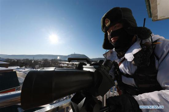 A soldier is on duty in Beiji Village of the border county Mohe, northeast China's Heilongjiang Province, Feb. 5, 2018. Soldiers stick to their post at the border in spite of the severe cold in Mohe where the temperature has dropped to minus 40 degrees Celsius. (Xinhua/Li Gang)
