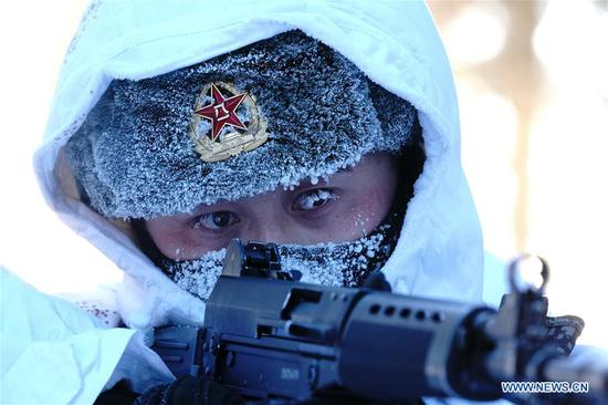 A soldier takes part in a training in Beiji Village of the border county Mohe, northeast China's Heilongjiang Province, Feb. 5, 2018. Soldiers stick to their post at the border in spite of the severe cold in Mohe where the temperature has dropped to minus 40 degrees Celsius. (Xinhua/Li Gang)