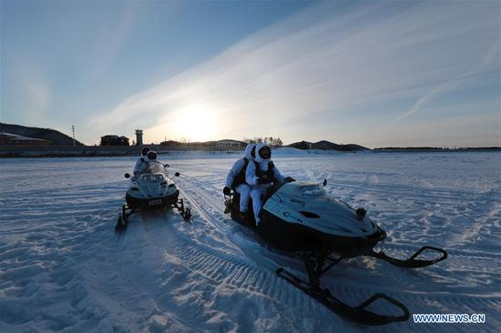 Soldiers patrol by snowmobile in Beiji Village of the border county Mohe, northeast China's Heilongjiang Province, Feb. 5, 2018. Soldiers stick to their post at the border in spite of the severe cold in Mohe where the temperature has dropped to minus 40 degrees Celsius. (Xinhua/Li Gang)