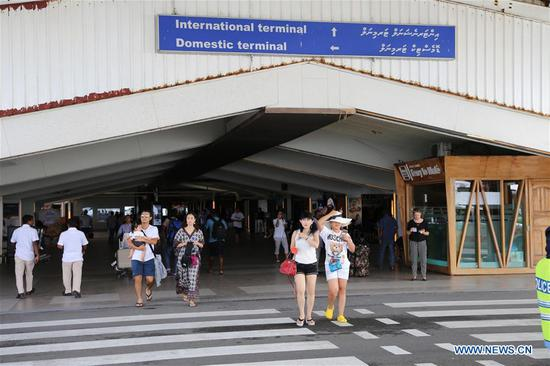 Tourists walk out of the airport in Male, Maldives, Feb. 7, 2018. Maldivian President Abdulla Yameen on Monday evening declared a state of emergency amid political crisis in the country. (Xinhua/Zhu Ruiqing)