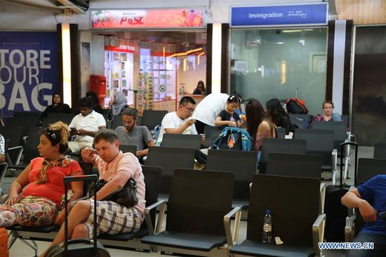 Tourists take a rest at the airport in Male, Maldives, Feb. 7, 2018. Maldivian President Abdulla Yameen on Monday evening declared a state of emergency amid political crisis in the country. (Xinhua/Zhu Ruiqing)