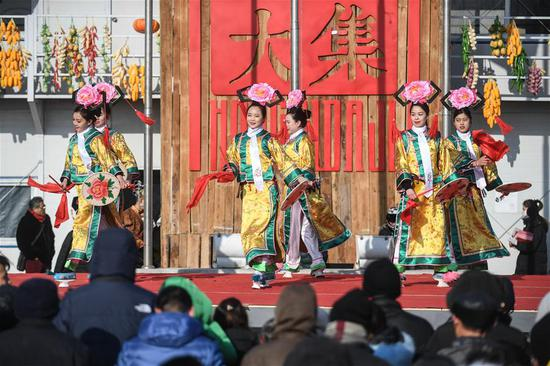 Actresses perform a folk show at a grand fair in Yingkou City of northeast China's Liaoning Province, on Feb. 8, 2018, the day of Xiaonian (small year). Xiaonian falls on the 23rd or 24th day of the last month of the Chinese traditional lunar calendar, marking the start of the countdown to Spring Festival. (Xinhua/Pan Yulong)
