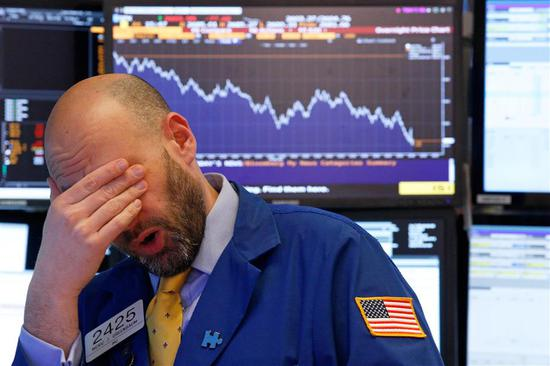 A trader reacts near the end of the day on the floor of the New York Stock Exchange in New York, US, on February 8, 2018.