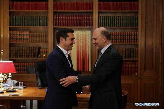 Greek Prime Minister Alexis Tsipras (L) meets European Commissioner for Economic and Financial Affairs Pierre Moscovici in Athens, Greece, on Feb. 8, 2018. European Commissioner for Economic and Financial Affairs Pierre Moscovici voiced optimism on Thursday over the issue of the Greek debt load and Greek economy's course in the post-bailout era. (Xinhua/Marios Lolos)