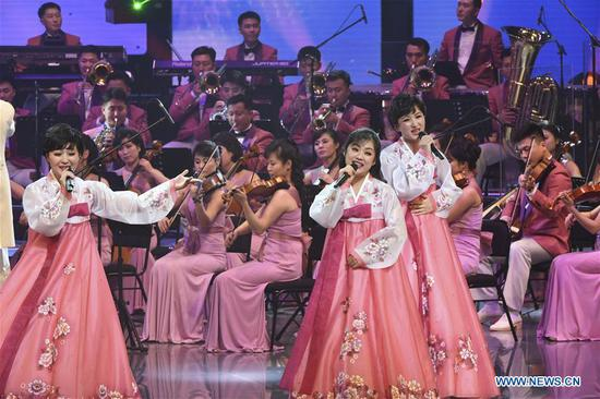 The Samjiyon orchestra members give performance in the Arts Center of Gangneung, South Korea, on Feb. 8, 2018. The Samjiyon orchestra from the Democratic People's Republic of Korea (DPRK) staged a performance in the South Korean city of Gangneung on Thursday night before the opening of the PyeongChang Winter Olympics. (Xinhua/Pool)