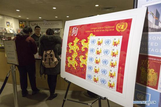 The Year of the Dog stamp sheet is pictured at the United Nations Postal Administration (UNPA), at the UN headquarters in New York, Feb. 7, 2018. The stamp sheet, consisting of 10 stamps of a denomination of 1.15 U.S. dollars, with the paper-cut images of dogs and UN logo, as the Chinese lunar year for 2018 is the Year of the Dog. This new sheet is the ninth of the UNPA's Lunar New Year stamp series. (Xinhua/Li Muzi)