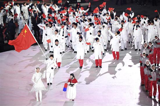 The delegation of China march in during the opening ceremony of the 2018 PyeongChang Winter Olympic Games at PyeongChang Olympic Stadium in PyeongChang, South Korea, Feb. 9, 2018. (Xinhua/Ju Huanzong)