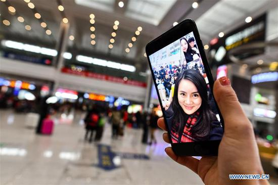Zhang Yuliang makes a video call with her friend at the waiting room of the Chongqing North Railway Station in Chongqing, southwest China, Feb, 9, 2018. Zhang Yuliang, a 25-year-old girl from Chongqing, loves to record daily life by smart phone. She took photos of the trip from Chongqing North Railway Station to Dazu South Railway Station during the Spring Festival travel rush. (Xinhua/Liu Chan)