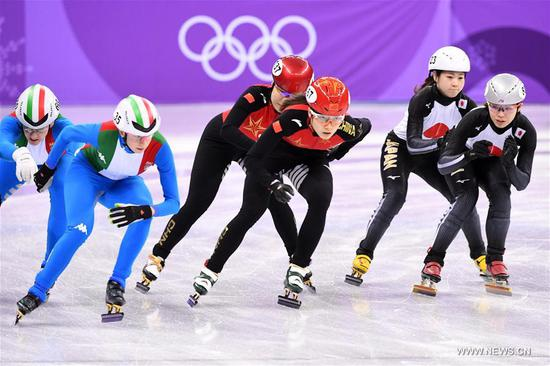 China's Qu Chunyu (front C) and Zhou Yang (rear C) compete during the women's 3000m relay heat of short track speed skating event of 2018 PyeongChang Winter Olympic Games at Gangneung Ice Arena, South Korea, Feb. 10, 2018. China advanced to the final in a time of 4:05.315 and set a new Olympic record of the event. (Xinhua/Ju Huanzong)