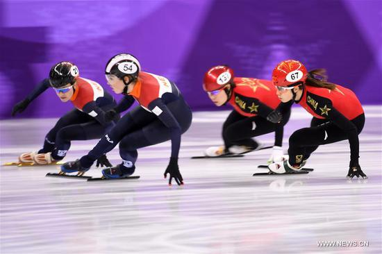 China's Qu Chunyu (1st R) and Zhou Yang (2nd R) compete during the women's 3000m relay heat of short track speed skating event of 2018 PyeongChang Winter Olympic Games at Gangneung Ice Arena, South Korea, Feb. 10, 2018. China advanced to the final in a time of 4:05.315 and set a new Olympic record of the event. (Xinhua/Ju Huanzong)