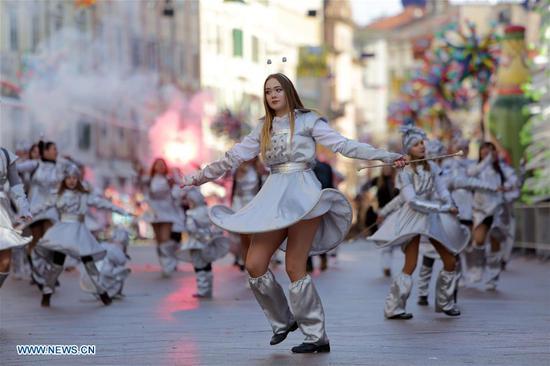 People take part in the International Carnival Parade in Rijeka, Croatia, on Feb. 11, 2018. (Xinhua/Nel Pavletic)