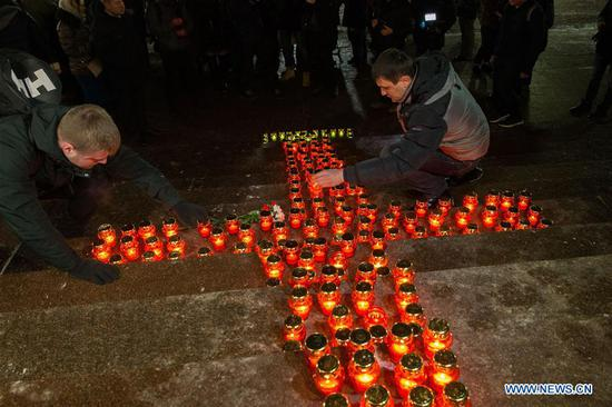 People place candles to mourn the victims in the AN-148 passenger jet crash near the Cathedral of Christ the Saviour in Moscow, Russia, on Feb. 12, 2018. Rescuers have presumably recovered the second flight data recorder of the AN-148 passenger jet that crashed in the Moscow region on Sunday, the Russian Emergencies Ministry said Monday. On Sunday, an Antonov-148 of Saratov Airlines bound for the city Orsk in Russia's Orenberg Region bordering Kazakhstan crashed shortly after takeoff from Moscow's Domodedovo Airport, killing all people on board, including 65 passengers and six crew members. (Xinhua/Bai Xueqi)