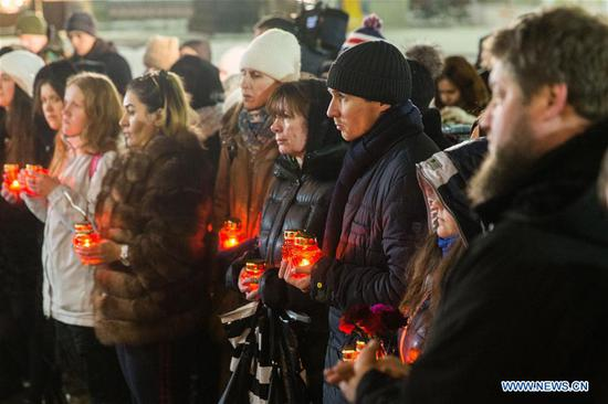 People mourn the victims in the AN-148 passenger jet crash near the Cathedral of Christ the Saviour in Moscow, Russia, on Feb. 12, 2018. Rescuers have presumably recovered the second flight data recorder of the AN-148 passenger jet that crashed in the Moscow region on Sunday, the Russian Emergencies Ministry said Monday. On Sunday, an Antonov-148 of Saratov Airlines bound for the city Orsk in Russia's Orenberg Region bordering Kazakhstan crashed shortly after takeoff from Moscow's Domodedovo Airport, killing all people on board, including 65 passengers and six crew members. (Xinhua/Bai Xueqi)