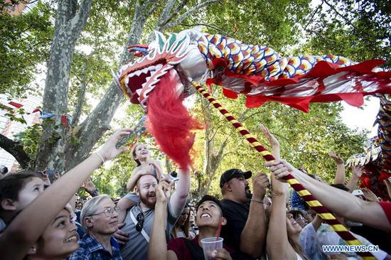 People enjoy the celebration of the Chinese Lunar New Year, in Buenos Aires, Argentina on Feb. 10, 2018. Argentinean citizens and Chinese residents in Buenos Aires gathered on Saturday in the Parques Nacionales Square to celebrate the Spring Festival and enjoy a show of traditional dance, music and acrobatics to welcome the Chinese New Year. (Xinhua/Martin Zabala)