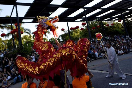 Members of the Uruguay Shaolin Chuan School perform a Dragon Dance during celebrations of the Chinese Lunar New Year, in Montevideo, capital of Uruguay, on Feb. 10, 2018. (Xinhua/Nicolas Celaya)