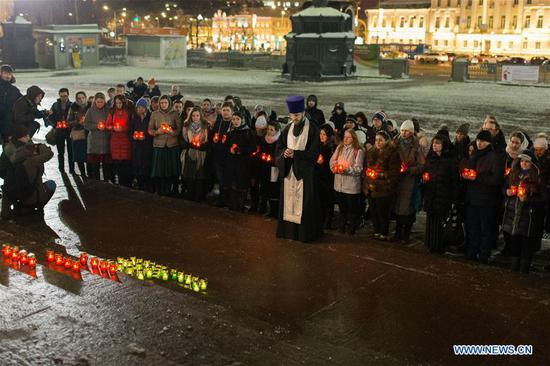 People attend a memorial service to mourn the victims in the AN-148 passenger jet crash near the Cathedral of Christ the Saviour in Moscow, Russia, on Feb. 12, 2018. Rescuers have presumably recovered the second flight data recorder of the AN-148 passenger jet that crashed in the Moscow region on Sunday, the Russian Emergencies Ministry said Monday. On Sunday, an Antonov-148 of Saratov Airlines bound for the city Orsk in Russia's Orenberg Region bordering Kazakhstan crashed shortly after takeoff from Moscow's Domodedovo Airport, killing all people on board, including 65 passengers and six crew members. (Xinhua/Bai Xueqi)