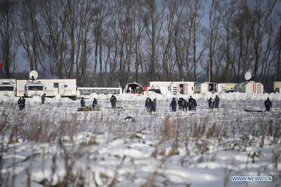 Russian Emergencies Ministry officers work at the scene where the AN-148 passenger jet crashed on Feb. 11 in the Moscow region of Russia on Feb. 12, 2018. Rescuers have presumably recovered the second flight data recorder of the AN-148 passenger jet that crashed in the Moscow region on Sunday, the Russian Emergencies Ministry said Monday. (Xinhua/Sputnik)