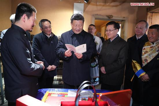 Chinese President Xi Jinping, also general secretary of the Communist Party of China Central Committee and chairman of the Central Military Commission, learns about the development of tea industry that benefits local people in Yingxiu Town of Wenchuan County, southwest China's Sichuan Province, Feb. 12, 2018. Xi made an inspection tour in Sichuan on Feb. 12. (Xinhua/Ju Peng)