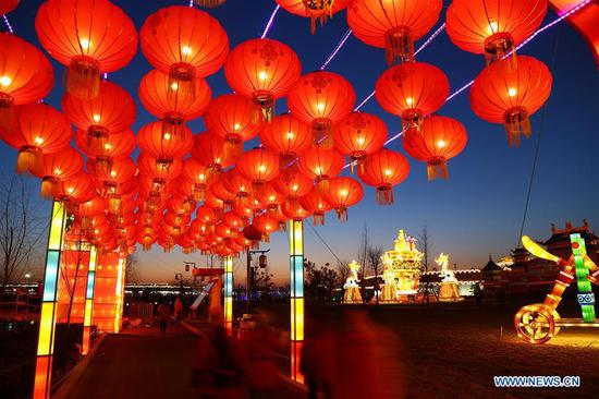 Festive lanterns are displayed during a lantern fair to greet the upcoming Spring Festival in Zhengding County of Shijiazhuang, capital of north China's Hebei Province, Feb. 12, 2018. The Spring Festival, or the Chinese Lunar New Year, falls on Feb. 16 this year. (Xinhua/Shuang Pengfei)