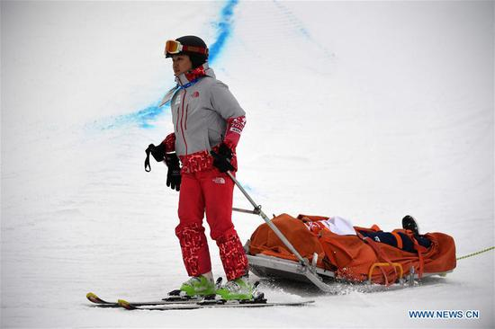 Yuto Totsuka of Japan is stretchered off after a crash during men's halfpipe finals of snowboard at 2018 PyeongChang Winter Olympic Games at Phoenix Snow Park, in PyeongChang, South Korea, Feb. 14, 2018. (Xinhua/Lui Siu Wai)