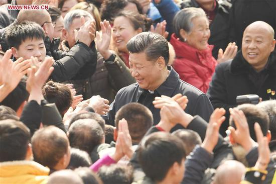 Chinese President Xi Jinping, also general secretary of the Communist Party of China Central Committee and chairman of the Central Military Commission, talks with villagers in Zhanqi Village of Pidu District in Chengdu, southwest China's Sichuan Province, Feb. 12, 2018. Xi made an inspection tour in Sichuan and extended greetings ahead of the Spring Festival, which falls on Feb. 16 this year. (Xinhua/Zhang Duo)