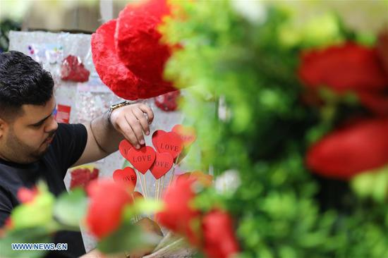 A shop owner arranges gifts for the upcoming Valentine's Day in Baghdad, Iraq, on Feb. 13, 2018. (Xinhua/Khalil Dawood)