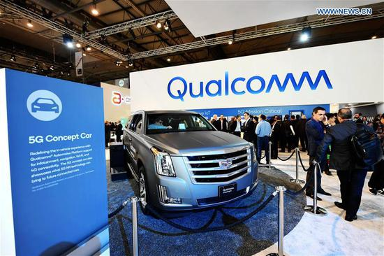 People visit the Qualcomm 5G Concept Car on the first day of the 2018 Mobile World Congress (MWC) in Barcelona, Spain, on Feb. 26, 2018. The four-day 2018 MWC opened on Monday. (Xinhua/Guo Qiuda)