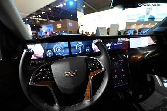 Photo taken on Feb. 26, 2018 shows the interior of the Qualcomm 5G Concept Car during the 2018 Mobile World Congress (MWC) in Barcelona, Spain. The four-day 2018 MWC opened on Monday. (Xinhua/Guo Qiuda)