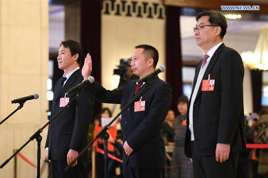 Chen Hong, Wang Jianqing and Guo Rui (R to L), deputies to the 13th National People's Congress (NPC), receive an interview before the opening meeting of the first session of the 13th NPC in Beijing, capital of China, March 5, 2018. (Xinhua/Gao Jie)