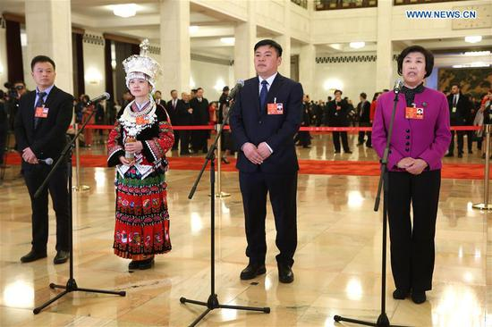 Guo Fenglian, Gong Baoxiong, Yang Changqin and Zuo Xiangyun (R to L), deputies to the 13th National People's Congress (NPC), receive an interview before the opening meeting of the first session of the 13th NPC in Beijing, capital of China, March 5, 2018. (Xinhua/Jin Liwang)