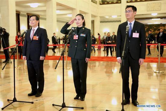 Ma Huateng (R), Wang Yaping (C) and Xu Liyi, deputies to the 13th National People's Congress (NPC), receive an interview before the opening meeting of the first session of the 13th NPC in Beijing, capital of China, March 5, 2018. (Xinhua/Jin Liwang)