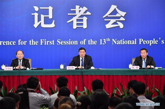 Head of the National Development and Reform Commission (NDRC) He Lifeng (C), deputy heads of the NDRC Zhang Yong (R) and Ning Jizhe, take questions during a press conference on innovation and improvement of macro-economic control and promotion of high quality development for the first session of the 13th National People's Congress in Beijing, capital of China, March 6, 2018. (Xinhua/Li Xin)