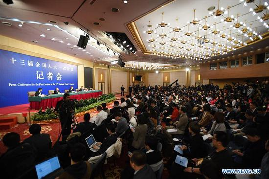 A press conference on innovation and improvement of macro-economic control and promotion of high quality development for the first session of the 13th National People's Congress is held in Beijing, capital of China, March 6, 2018. (Xinhua/Wang Jianhua)