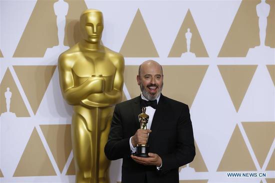 Mark Bridges poses after winning the Best Costume Design award for