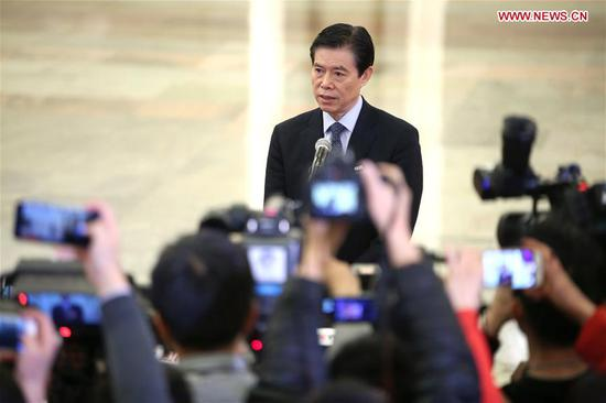Chinese Minister of Commerce Zhong Shan receives an interview after the opening meeting of the first session of the 13th National People's Congress at the Great Hall of the People in Beijing, capital of China, March 5, 2018. (Xinhua/Jin Liwang)