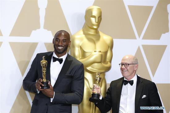 Former U.S. basketball player Kobe Bryant (L) and director Glen Keane pose after winning the Best Animated Short Film award for