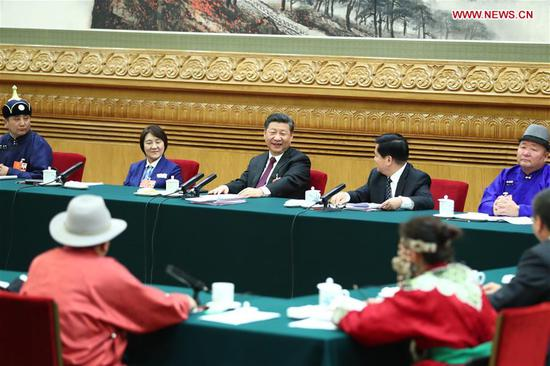 Chinese President Xi Jinping, also general secretary of the Communist Party of China (CPC) Central Committee and chairman of the Central Military Commission, joins a panel discussion with the deputies from Inner Mongolia Autonomous Region at the first session of the 13th National People's Congress in Beijing, capital of China, March 5, 2018. (Xinhua/Xie Huanchi)