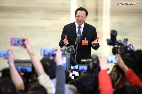 Chinese Minister of Agriculture Han Changfu receives an interview after the opening meeting of the first session of the 13th National People's Congress at the Great Hall of the People in Beijing, capital of China, March 5, 2018. (Xinhua/Jin Liwang)