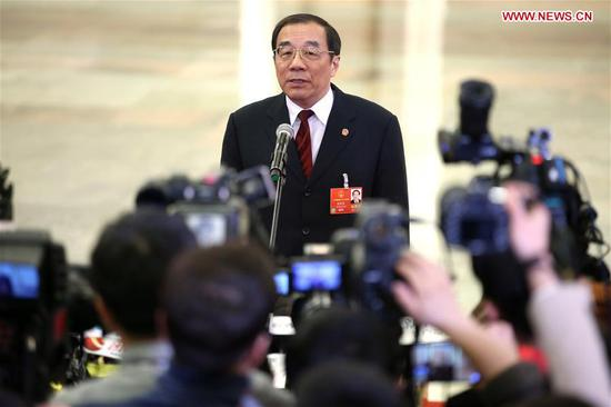 Chinese Minister of Supervision Yang Xiaodu receives an interview after the opening meeting of the first session of the 13th National People's Congress at the Great Hall of the People in Beijing, capital of China, March 5, 2018. (Xinhua/Jin Liwang)