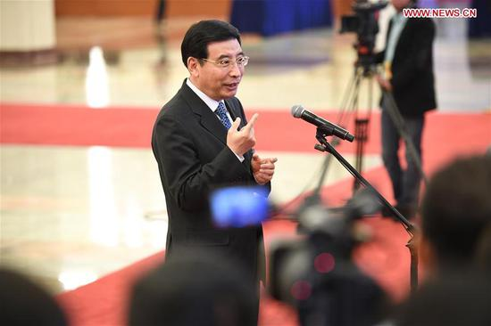 Miao Wei, Minister of Industry and Information Technology, receives an interview after the opening meeting of the first session of the 13th National People's Congress at the Great Hall of the People in Beijing, capital of China, March 5, 2018. (Xinhua/Wang Jianhua)