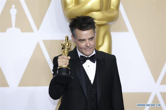 Director Sebastian Lelio poses after winning the Best Foreign Language Film award for