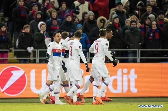Players of Lyon celebrate scoring during the UEFA Europa League round of 16 first leg match between Russia's CSKA and France's Lyon, in Moscow, Russia, March 8, 2018. Lyon won 1-0. (Xinhua/Wu Zhuang)