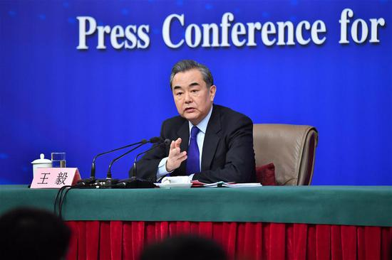 Chinese Foreign Minister Wang Yi answers questions on China's foreign policies and foreign relations at a press conference on the sidelines of the first session of the 13th National People's Congress in Beijing, capital of China, March 8, 2018. (Xinhua/Li Xin)