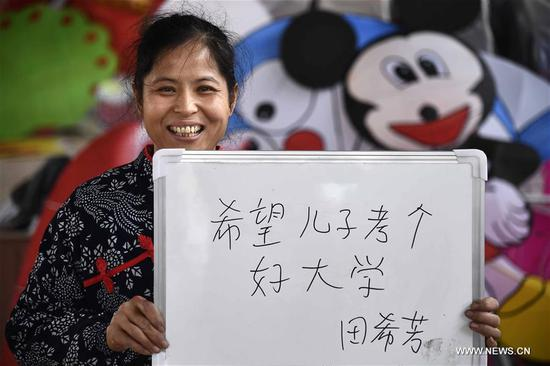Tian Xifang, an inheritor of intangible cultural heritage, displays her wish reading